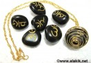 Black Sanskrit Tumble stone set with golden cage necklace