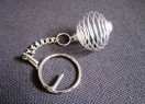 Key ring with cage